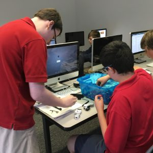 photo of students working on a project