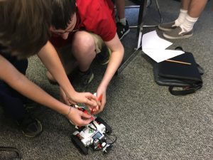 photo of students working on robotics project