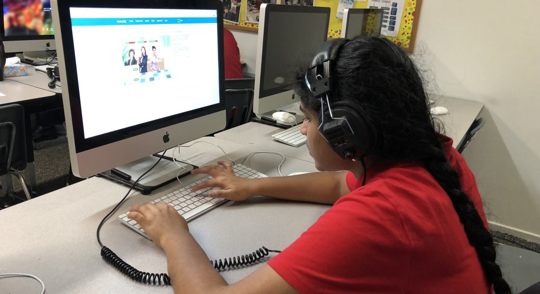 photo of student using computer