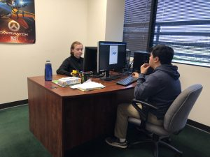 photo of two students using computers